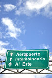 Freeway signs directing drivers under the blue sky. With clouds Stock Photos
