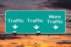 Freeway to More Traffic Road Sign. With sunset sky Stock Images
