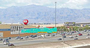 Freeway traffic. In Las Vegas with green boards for directions Royalty Free Stock Photos