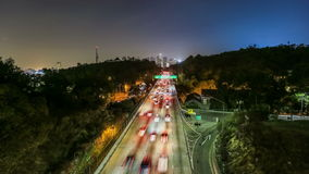 Freeway Traffic Time Lapse. With Los Angeles cityscape in background stock video footage