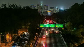Freeway Traffic Time Lapse. With Los Angeles cityscape in background stock footage