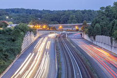 Freeway with train tracks. Evening view of freeway with train tracks royalty free stock images