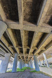 Freeway underpass with pillars and grass Royalty Free Stock Photography