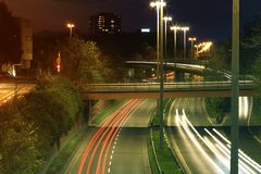 Freeway with urban night traffic with focusing on the road. Car. Trails on a highway Royalty Free Stock Images