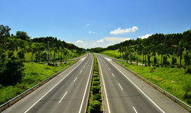 Freeway,White Clouds and Blue Sky. The freeway with white clouds and blue sky,summer Stock Photography