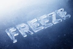 Freeze. Word Freeze made of real ice letters on ice background stock photography