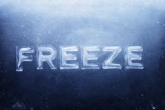 Freeze. Word Freeze made of letters made of real ice royalty free stock images