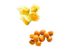 Freeze dried and fresh physalis on a white background. Lyophilization. Food for astronauts. Isolated Stock Images
