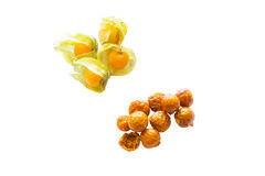 Freeze dried and fresh physalis on a white background. Lyophilization. Food for astronauts. Isolated Royalty Free Stock Photos