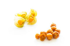 Freeze dried and fresh physalis on a white background. Freeze dried and fresh physalis on a white background with shadow. Lyophilization. Food for astronauts Stock Photo