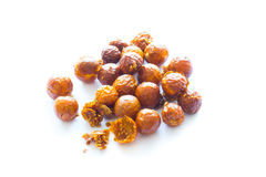 Freeze dried physalis on a white background. Freeze dried physalis on a white background with shadow. Lyophilization. Food for astronauts Stock Image