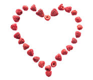 Freeze dried raspberries on a white background in the form of heart. Lyophilization. Food for astronauts. royalty free stock photo