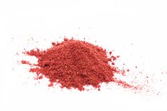 Freeze dried strawberries on a white background, powder royalty free stock photos