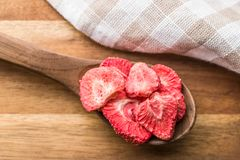 Freeze dried strawberry slices. In wooden spoon Stock Photography