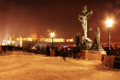 Freeze foggy night snowy Prague gothic Castle with Statues, Czech Republic Stock Photography