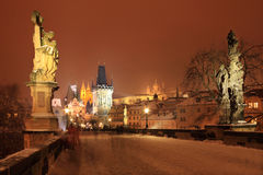 Freeze foggy night snowy Prague gothic Castle with Statues, Czech Republic Stock Photos