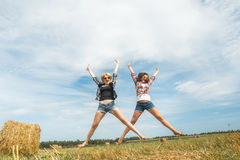 Freeze frame shot with balanced flight of girls jumping Stock Images