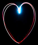 Freeze light painted heart on a black Stock Photos