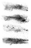 Freeze motion of black dust explosions on white background stock photography