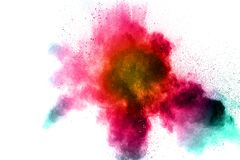 Freeze motion of color particles on white background. Multicolored granule of powder explosion. Abstract color dust overlay texture Royalty Free Stock Photo