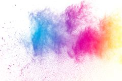 Freeze motion of color powder splash. Abstract multicolored powder splatter on black background,Freeze motion of color powder splash. Color dust explosion on stock photos