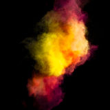 Freeze motion of colored dust explosion. Isolated on black background Royalty Free Stock Photos
