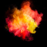 Freeze motion of colored dust explosion. Isolated on black background stock image