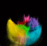 Freeze motion of colored dust explosion. Royalty Free Stock Images