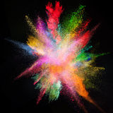 Freeze motion of colored dust explosion. Freeze motion of colored dust explosion isolated on black background Stock Photo