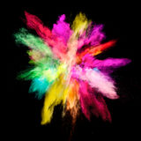 Freeze motion of colored dust explosion. Isolated on black background royalty free stock photo