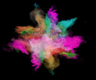 Freeze motion of colored dust explosions on black. Freeze motion of colored dust explosions isolated on black background royalty free stock photos