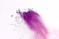 Freeze motion of colored powder explosion isolated on black background. Abstract of Multicolor dust splatted. royalty free stock photography