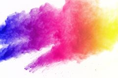 Freeze motion of colored powder explosions isolated on white background. stock photos