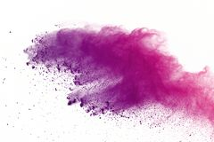 Freeze motion of colored powder explosions isolated on white background. royalty free stock images