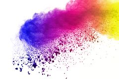 Freeze motion of colored powder explosions isolated on white background. royalty free stock image