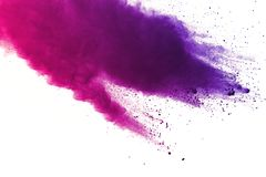 Freeze motion of colored powder explosions isolated on white background royalty free stock photo