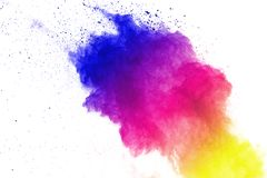 Freeze motion of colored powder explosions isolated on white background royalty free stock image