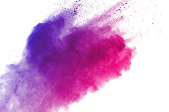 Freeze motion of colored powder explosions isolated on white background stock photos