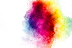 Freeze motion of colored powder explosions isolated on white background. Color dust particle splattered on background stock images