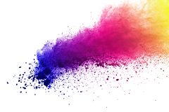 Freeze motion of colored powder explosions isolated on white background. stock photo