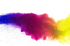 Freeze motion of colored powder explosions isolated on white background royalty free stock photos
