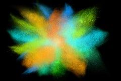 Freeze motion of colorful powder exploding Stock Image