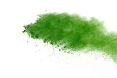 Freeze motion of Green powder exploding on white background. stock photography