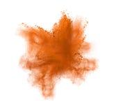 Freeze motion of Orange powder exploding, isolated. On white. Abstract design Royalty Free Stock Image
