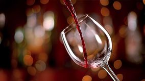 Freeze motion of pouring red wine into goblet. Freeze motion of pouring red wine from bottle into goblet. Low depth of focus royalty free stock photo