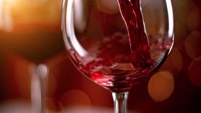 Freeze motion of pouring red wine into goblet. Freeze motion of pouring red wine from bottle into goblet. Low depth of focus royalty free stock images