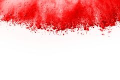 Freeze motion of red powder exploding, isolated on white background. Abstract design of red dust cloud. Particles explosion screen saver, wallpaper stock photography