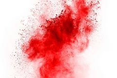 Freeze motion of red powder exploding, isolated on white background. Abstract design of red dust cloud. Particles explosion screen saver, wallpaper stock photo