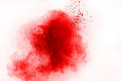 Freeze motion of red powder exploding, isolated on white background. Abstract design of red dust cloud. Particles explosion screen saver, wallpaper royalty free stock image