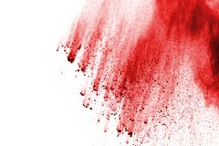 Red powder explosion on white background. Freeze motion of red powder exploding, isolated on white background. Abstract design of red dust cloud. Particles royalty free stock photography